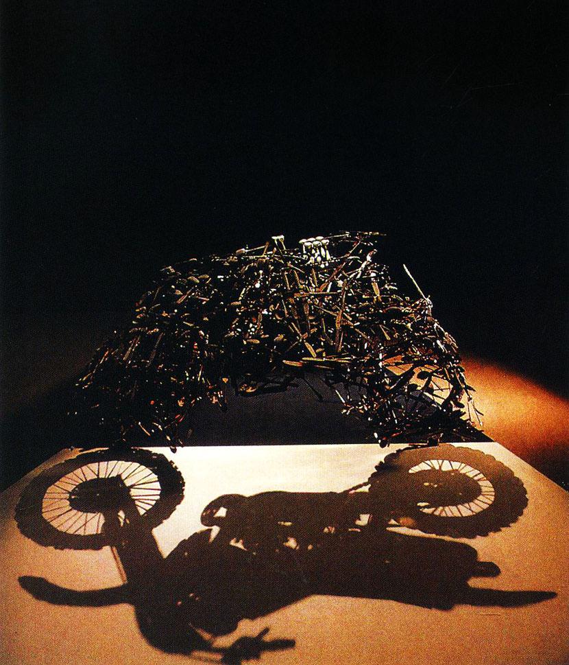 shadow sculpture motor bike optical illusion